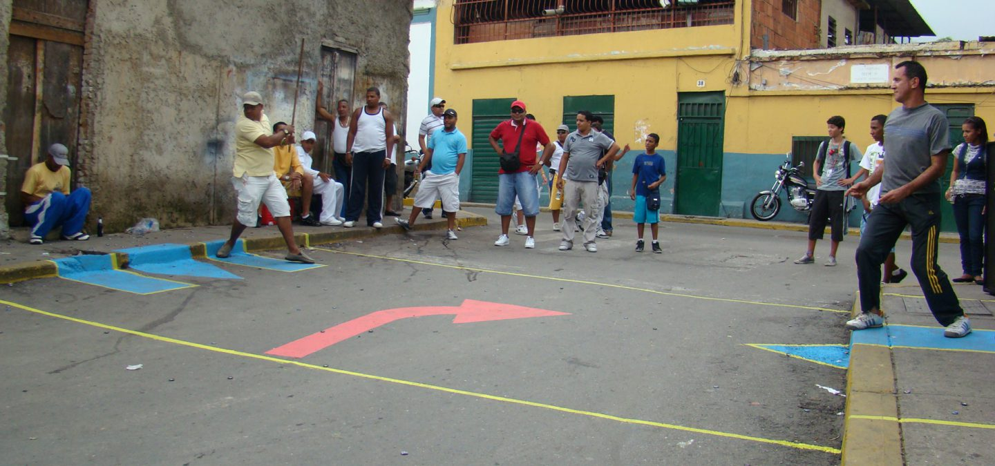 Street fun project implemented in La Pastora, drawing a 'field' to play a traditional street game called 'Chapita'